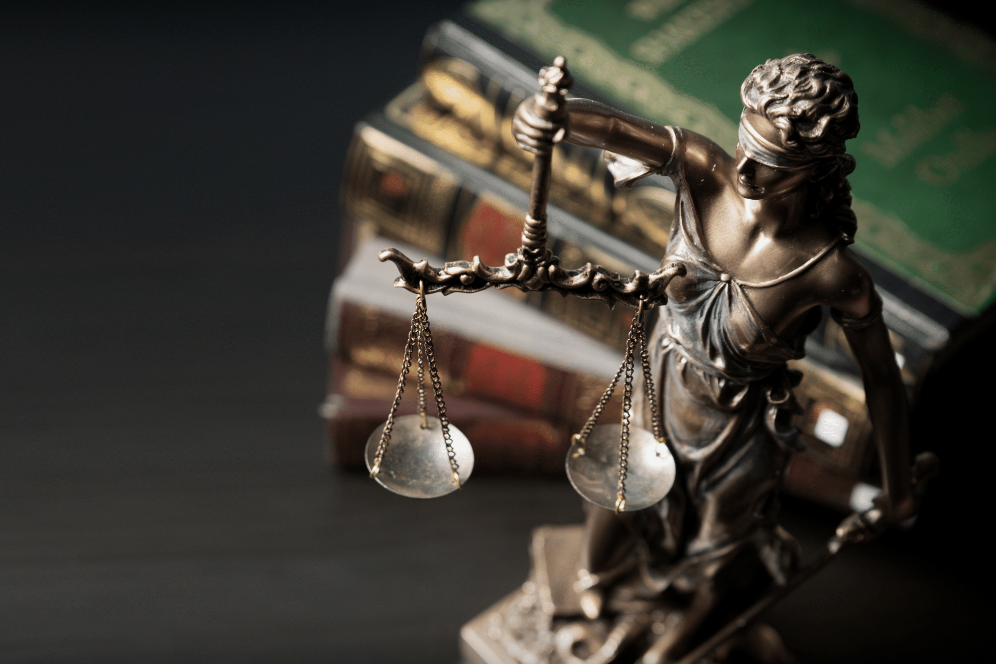 Lady Justice with law books in background